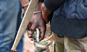 A member of the anti-balaka holds a grenade and a sabre at a checkpoint in Pissa, CAR. Photograph: Sia Kambou/AFP/Getty Images