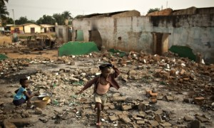 A girl walks through the rubble of demolished Muslim homes in the Miskine district of Bangui. Photograph: Siegfried Modola/Reuters