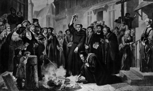Martersteig's depiction of Martin Luther burning the papal bull with 41 theses issued against him.