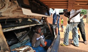 A girl sits in the boot of a car that is being searched at a Christian 'anti-balaka' checkpoint in the PK12 area of Bangui. Photograph: Sia Kambou/AFP/Getty Images