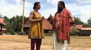 Sangita Iyer and Temple Priest Akkeramon Kalidasan Bhattathirippad